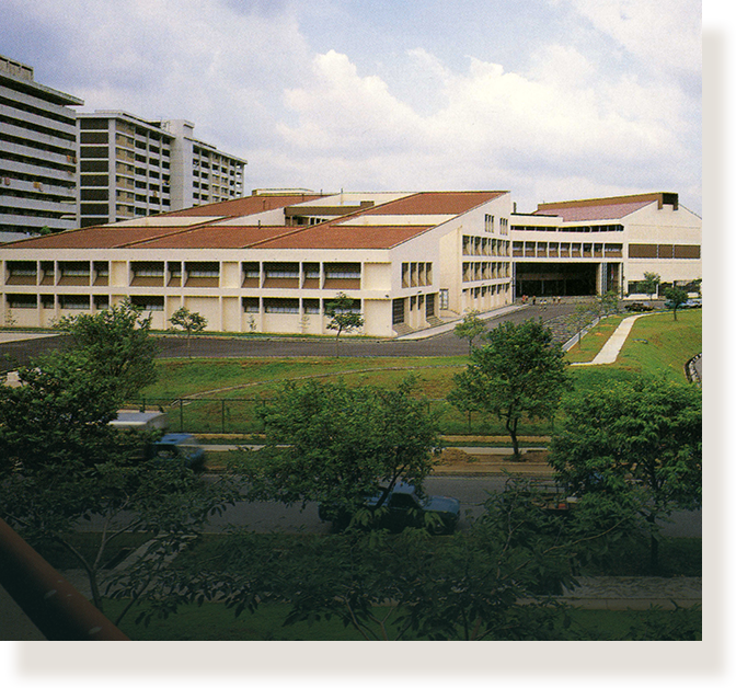 School design of the 1980s, featuring a sloping tiled roof as seen at Bedok Town Secondary School (1984).